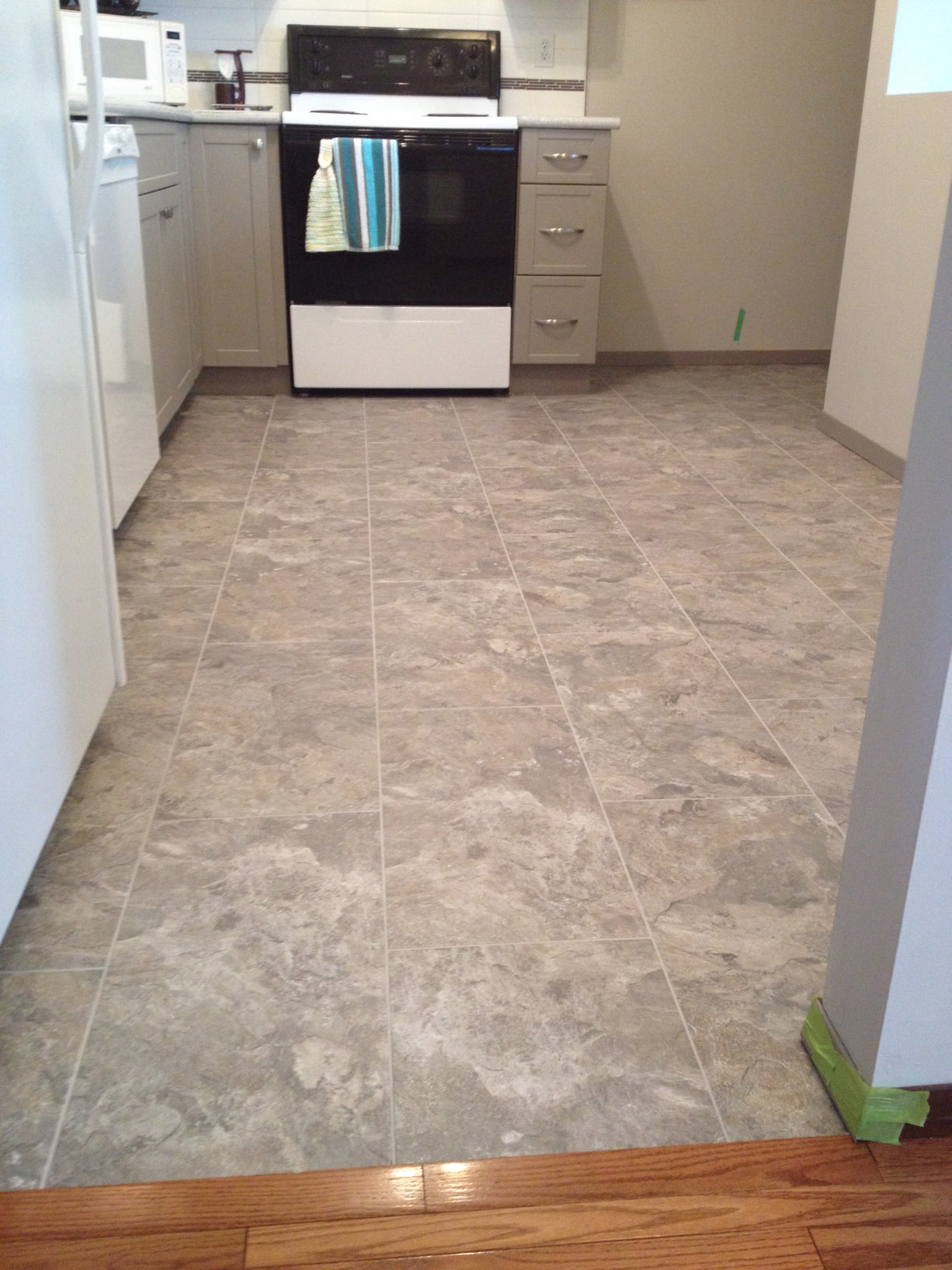 floor without replacing flooring removing pictures vinyl tile entity cabinets ideas kitchen